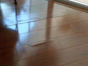 Insurance claim help for water damage to engineered wood flooring, as public adjusters we can help with this